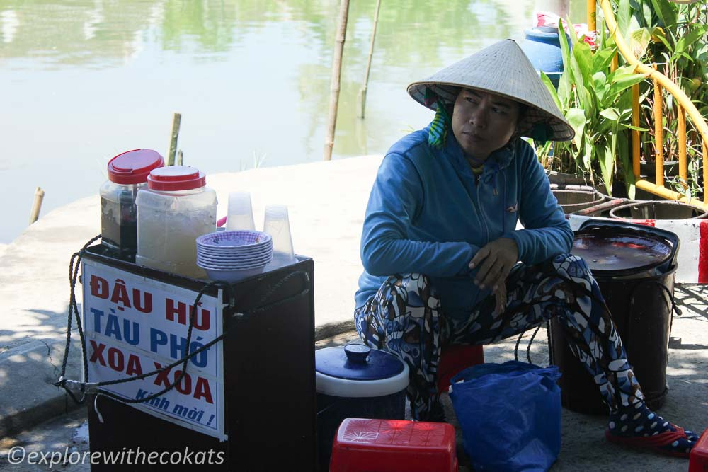 A local woman cooling off in a conical hat
